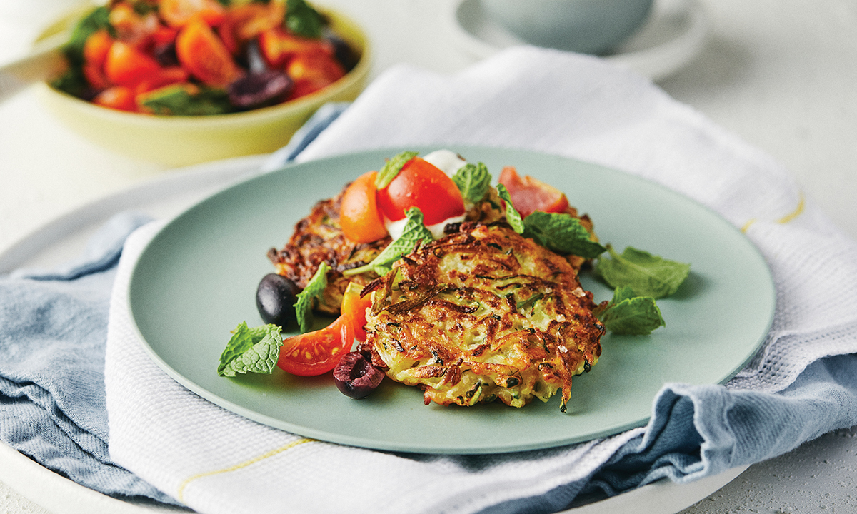 Recipe: Zucchini & halloumi fritters with tomato salad and herb yoghurt
